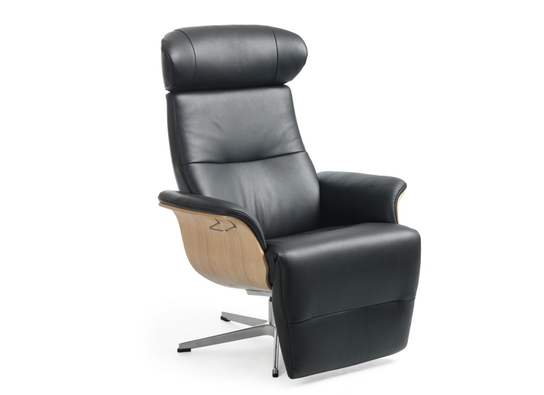 black leather armchair with built in footstool